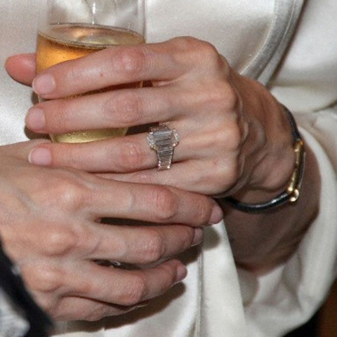 Brides.com: Our Favorite Celebrity Engagement Rings. Angelina Jolie's Engagement Ring Brad Pitt worked with jeweler Robert Procop for close to a year to design Angelina's table cut engagement ring. side diamonds are specially cut to encircle her finger.