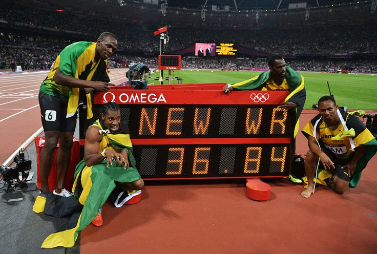 London 2012 - Usain Bolt (L), Yohan Blake, Nesta Carter and Michael Frater pose beside the score clock showing team Jamaica's new world record in the men's 4x100m relay at Olympic Stadium on August 11, 2012.  2012 Getty Images