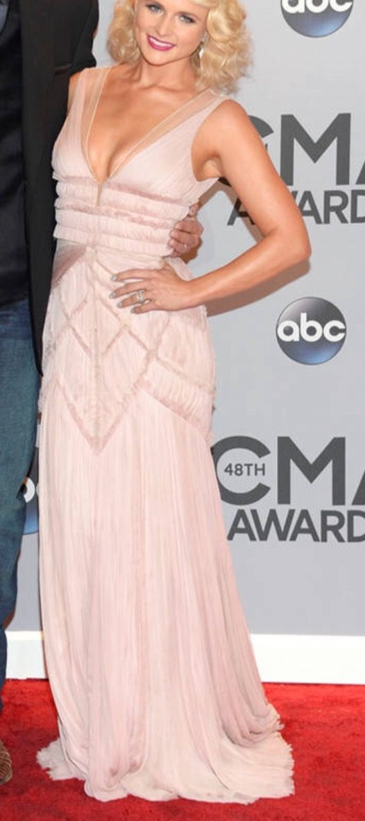 this is miranda lambert back in her married days after her weight loss/ besides all that loving the dress ifnyou wanted a gown that's comfortable wanting like art deco great gatsby or even just romantic vintage, a garden wedding and if u changed the hem line like exactly floor length no drag maybe abit in back this would be gorgeous at a sunset beach wedding/look @ dress now imagine its white! (blush or cream) i'll try find designer she's with blake in pic & she thin…