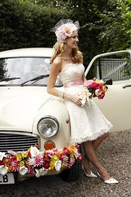 shiny old cream colored car with flower garland tied to front. just married tied to back.    this would be really cute for pics