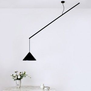 Veronika Gombert's Umleiter lamp  hangs offset from its ceiling rose