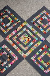 scrap quilt idea – gray must be the new black. It certainly makes those scrappy colors POP