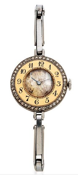 Lady's Diamond and Platinum Wristwatch, Agassiz, circa 1920's The circular case encircled by rose-cut diamonds, small dial surrounded by a gold bezel with Arabic numerals, manual winding movement, joined to an expandable bracelet, in platinum