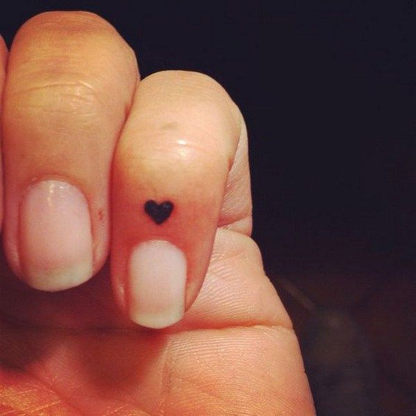 Micro Heart Tattoo on Finger.