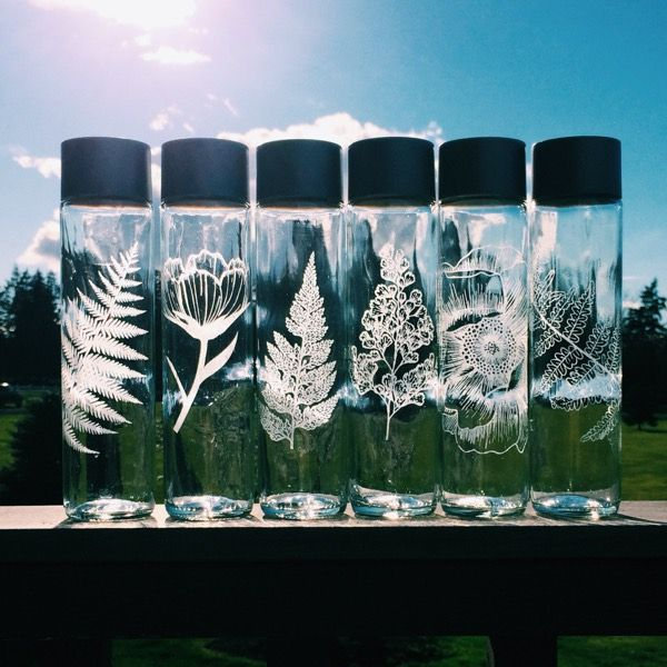 Etched Glass Water Bottle: These beautiful glass bottles make it easier to keep water always with you on the go while helping reduce plastic waste. Each bottle is hand etched with your choice of a design, therefor, each is unique.