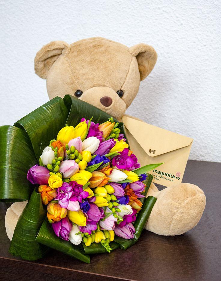 Spring bouquet and a teddy bear.The bouquet is made of tulips and freesias. Buchet de primăvară şi un ursuleţ de pluş. Buchetul conţine lalele şi frezii