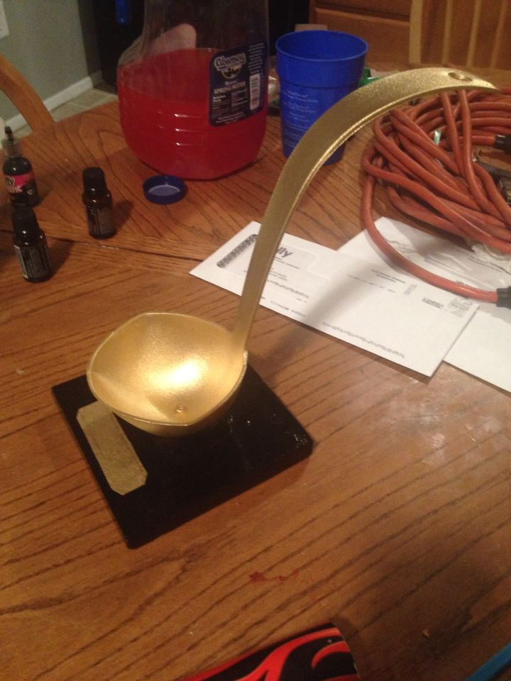 Golden ladle trophy for the chili cook off at work. Plastic ladle attached to a piece of wood and then painted.