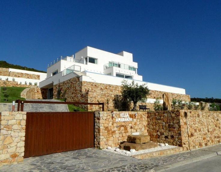 Villa Amarantaligt opeen berg met uitzicht op de oceaan tussen de Nationale Parken Strait en La Breña.