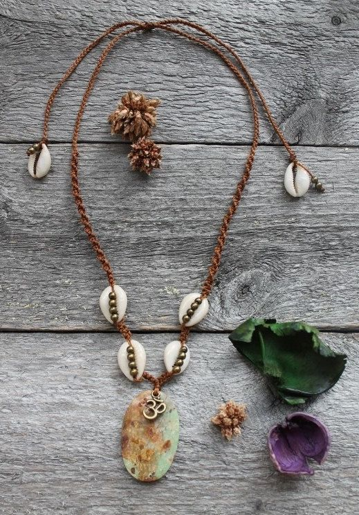 Natural turquoise Om-necklace with cowrieshand by SuryaSoul