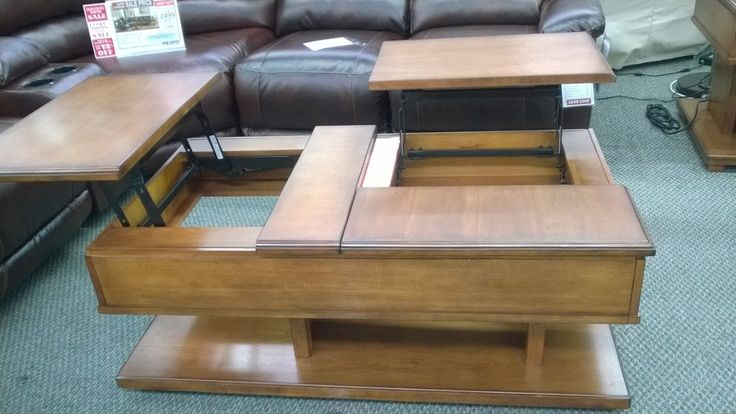 Interesting double lift coffee table, doesn't sit flush but neat idea from Ashley