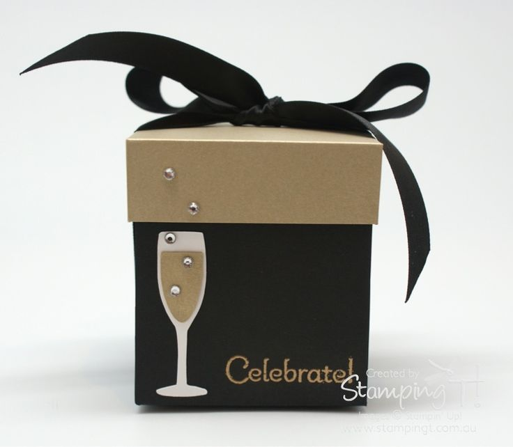 The champagne glass with bubbles is cute on this exploding box.