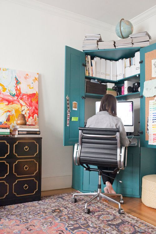 A corner desk offers just enough room for emailing and bill-paying, and uses space more efficiently than a standard rectangle tabletop would. This way, a bedroom-office combo can still feel spacious — and bonus points if your workspace can close up for the evening in a cabinet like this one. See more at Little Green Notebook »  - GoodHousekeeping.com