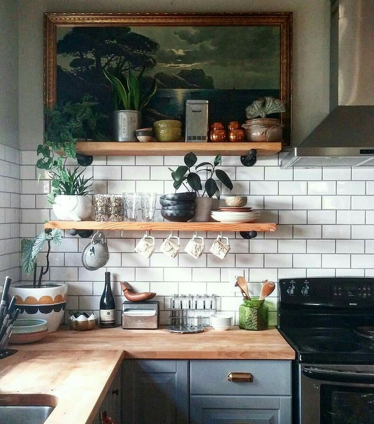 Pale blue kitchen units with white subway