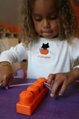 Teaching kids how to floss with blocks and yarn!  Genius!!!