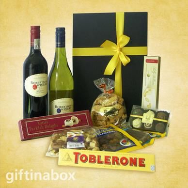 LET THERE BE MORE A tantalizing selection of gourmet goodies presented in an elegant black box with ribbons and bows. A unisex gift with something for everyone   bottle of selected red wine bottle of selected white wine 100g beef biltong 100g dry wors 100g mixed nuts 6 piece Belgian praline chocolate box 50g Sally William nougat 100g Almond biscuits 120g Turkish delights Chocolate bar