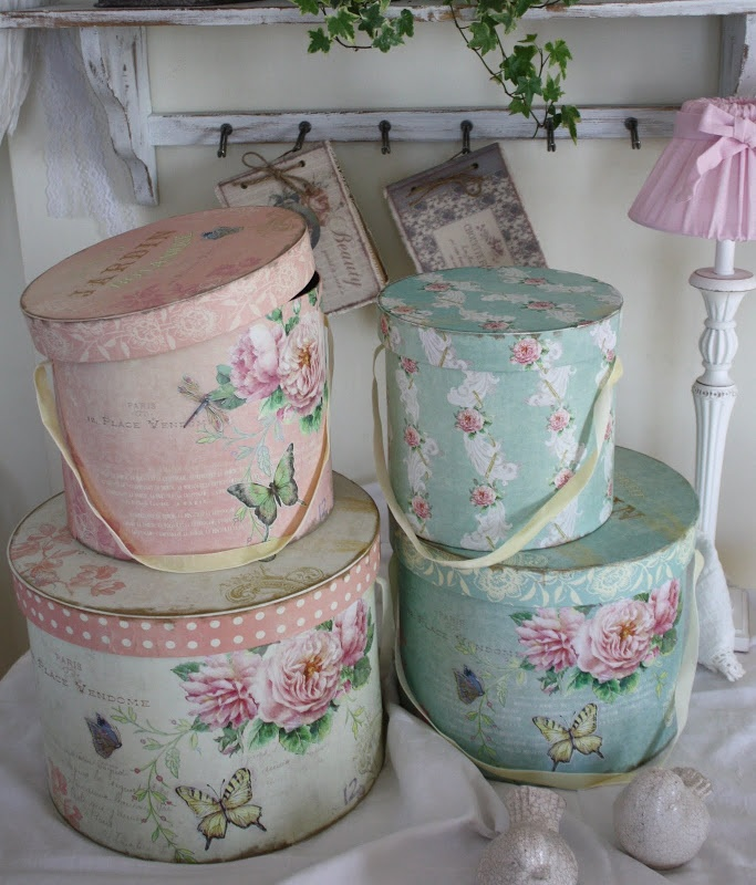 Pink and Aqua floral boxes make pretty storage places in a cottage or shabby chic home.