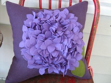 "Purple Hydrangea Pillow: Loving this felt soft sculpture! Wool felt on dark purple linen, 14 x 14"". $35."