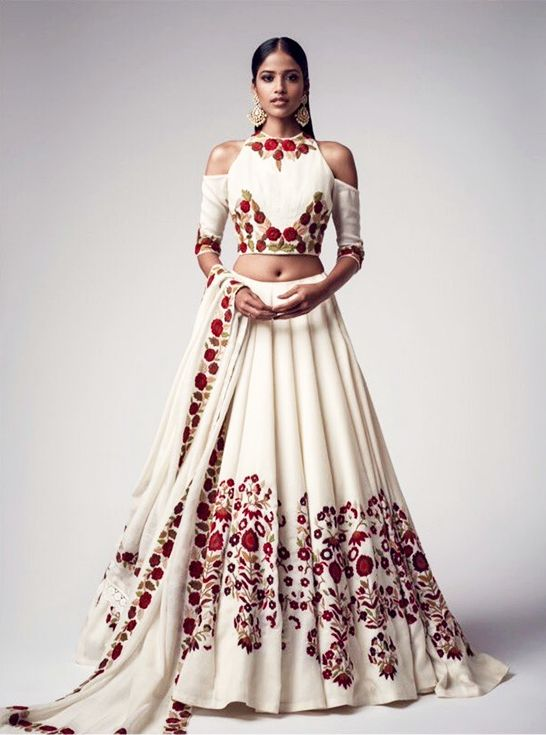 A gorgeous fusion lehenga with cut out shoulder blouse. (Image Source: fr.pinterest.com)