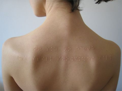 "Braille subdermal implants. Directly translates to: ""No sky, no earth, but still snowflakes fall."""