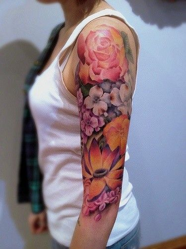 half sleeve watercolor tattoo of different flowers - upper arm, peony