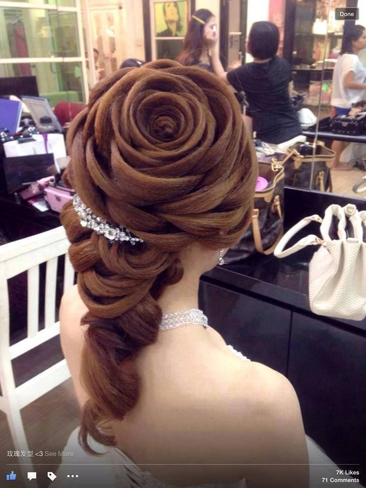 This looks like Belle from Beauty and the Beast!!   Rose hairstyle , so beautiful! Must have took SOOOOOO much time!