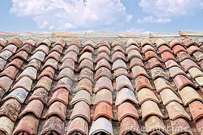 Typical clay roof tiles on a building in southern italy