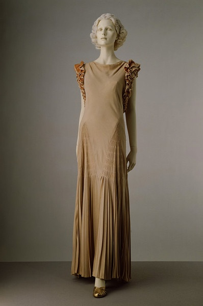 Evening dress    Place of origin:  London, England (made)    Date:  ca. 1933 (made)    Artist/Maker:  Hartnell, Norman, born 1901 - died 1979 (designer)    Materials and Techniques:  Silk crêpe faced with velvet