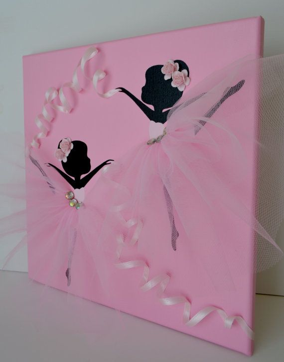 12 X 12 Dancing Ballerinas canvas. This wall art piece is painted with acrylic paint, decorated with tulle skirts, ribbon, rhinestones and roses.