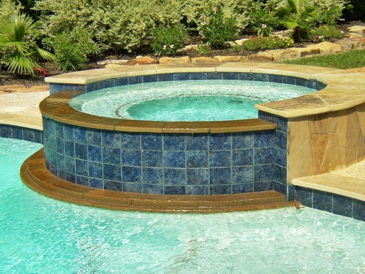 Inground pool with raised hot tub tile ideas spa round for Raised pool ideas
