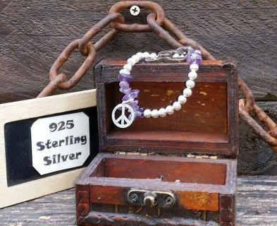 Gorgeous amethyst and sterling silver beads with a sterling silver #peace charm. This stretch bracelet will fit any size wrist. It's a stunner