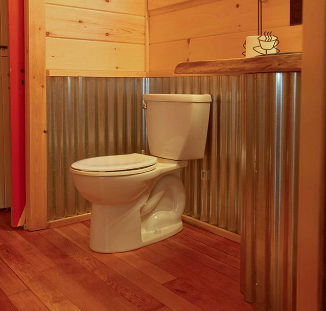 rustic cabins wrapped with tin on the outside | Corrugated Tin Shower Wall | ... is wrapped entirely with corrugated ...