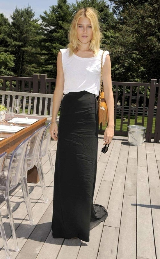 Model and actress, Dree Hemingway, white rolling up tee, simple maxi skirt and Chanel bag.