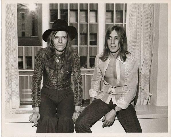 Bowie and Mick Ronson at the former's RCA signing in New York, September 1971. During the same trip, Bowie met Andy Warhol for the first time