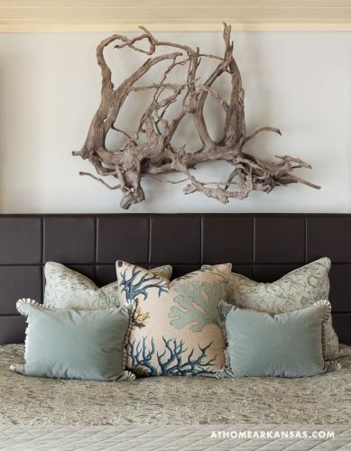 Driftwood used as natural art above headboard.  Browse Driftwood Decor at Completely Coastal: http://www.completely-coastal.com/search/label/Driftwood%20Decor