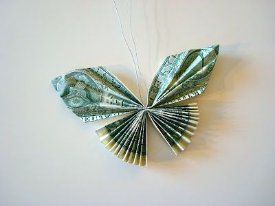 Tutorial on folding dollar bills into a butterfly......could be used for all sorts of different gifts