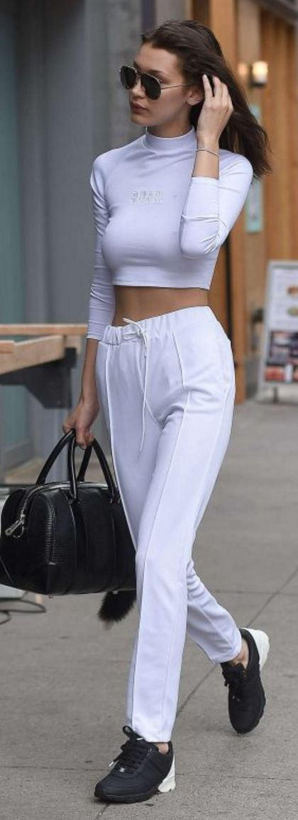Bella Hadid: Sunglasses – Christian Dior  Shirt and pants – Brash Sports (BRASHY)  Purse – Givenchy