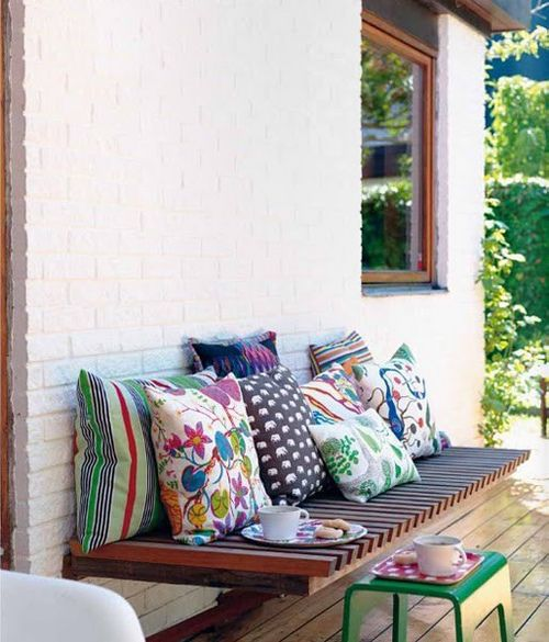 cozy outdoor living spaces by the style files, via Flickr. I love the built-in bench.