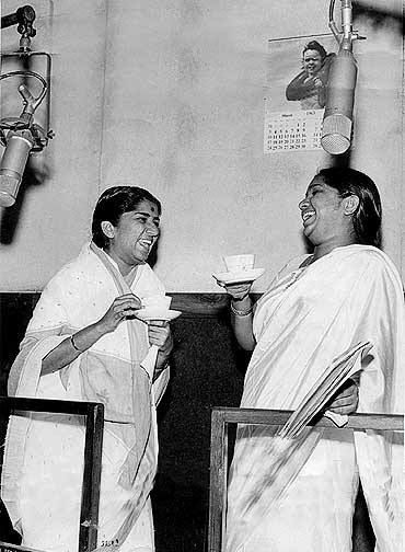 Lata & Asha - the most successful singers who sang for the Indian Film Industry (a rare picture of them recording together).