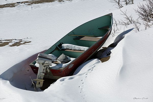 A boat stranded by the snow will see no use for several months. Carcross, Yukon.