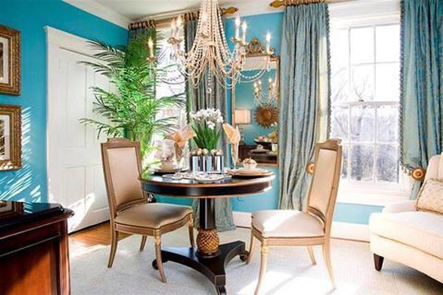 The chandelier and bold blue walls really make a statement in this room. To get…