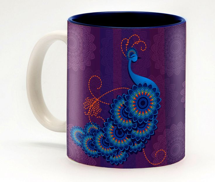 Abstract Peacock mug -the peacock's distinctive colouring is a gift from the god Indra.  In the midst of a battle between Indra and Ravana, the peacock – which in those days was just a big brown bird - raised its tail to form a screen behind which Indra could hide. To reward the bird for its compassion, Indra cast a spell, giving it the iconic jewel toned blue and green plumage that it bears to this day.