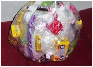 Tape Ball - Fun Game: What you need: Clear wide tape, small gifts or wrapped sweets | candy.  How to play:  Everyone playing gets into a big circle (this is not one of those