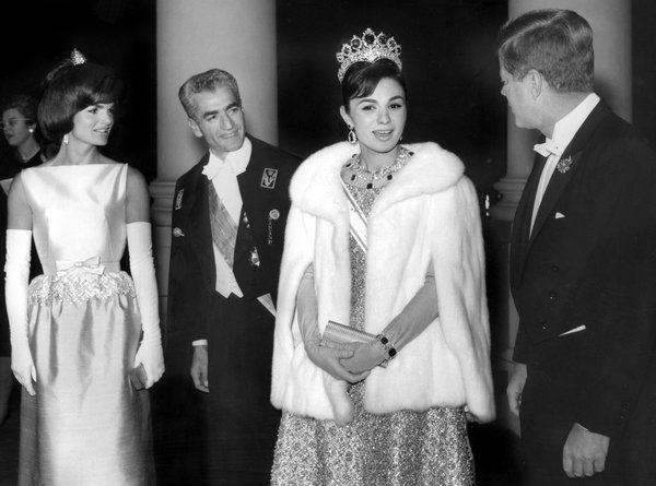 The shah of Iran, Mohammed Reza Pahlevi, center left, and his wife, Empress Farah, center right, with President John F. Kennedy and Jacqueline Kennedy.