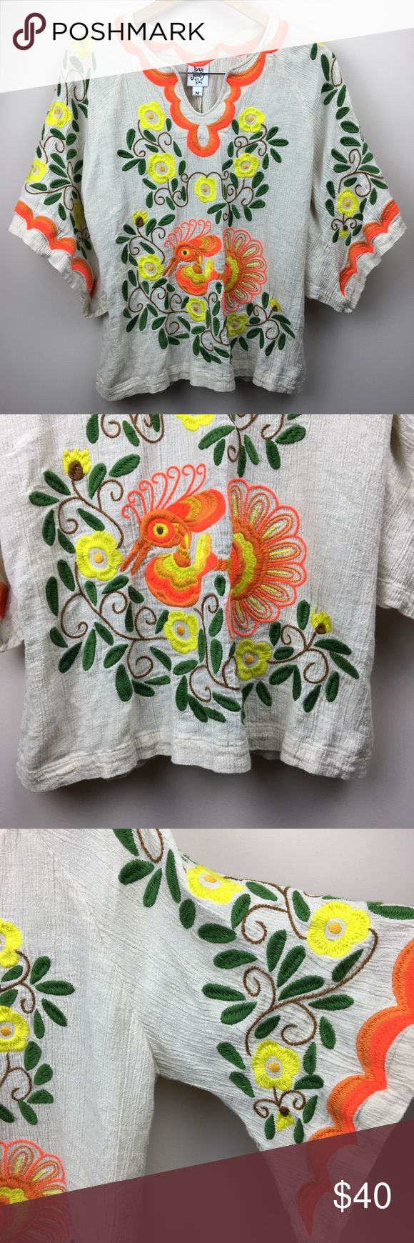 """Ivy Jane Bohemian Gypsy Floral Embroidered Blouse Ivy Jane Bohemian Gypsy Floral Embroidered Blouse. Batwing sleeves. Ivory colored with orange, green, yellow, and brown embroidery. Linen blend. Excellent like new condition. Perfect for upcoming festivals!   Approximate measurements laying flat: -bust 20"""" across  -length from shoulder seam 25"""" -sleeve length to longest tip 20 """" Ivy Jane Tops Blouses"""