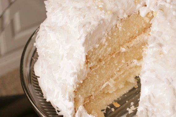 lady baltimore cake : a light, tender white cake, filled with a delicate orange marmalade filling, spread with a fluffy marshmallowy frosting and sprinkled all over with sweetened coconut.