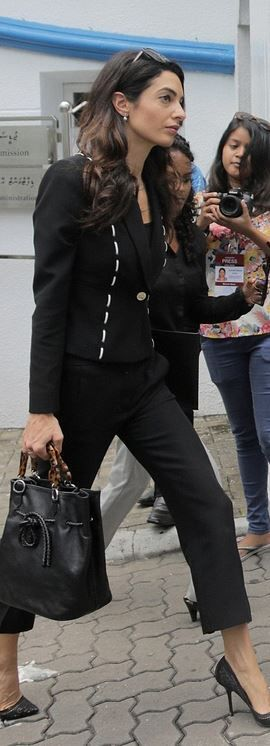 Who made Amal Clooney's black jacket and sunglasses?