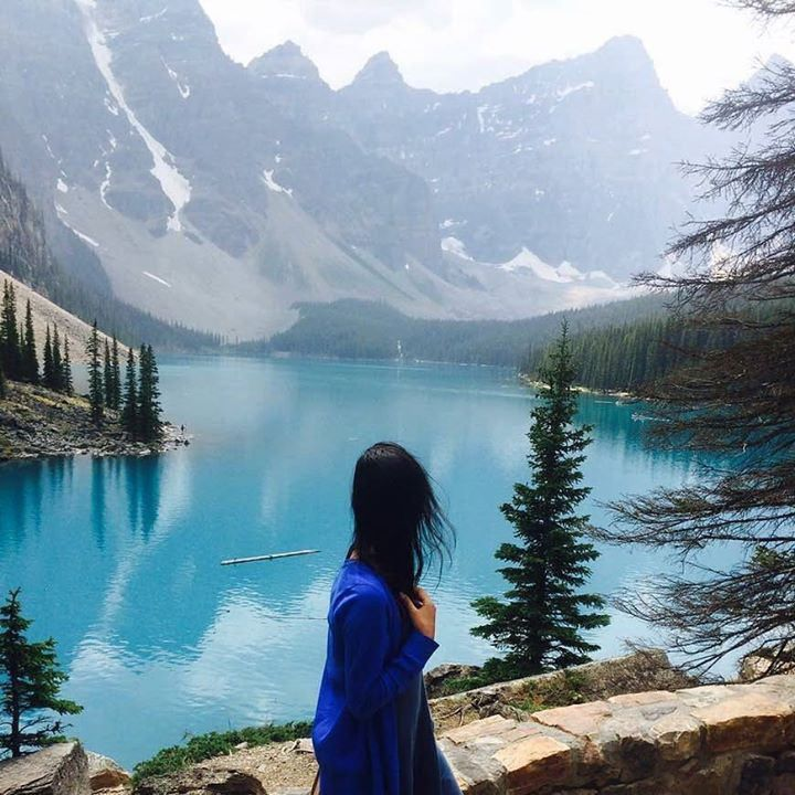 Turquoise waters mountain air epic selfies beware bear! Alberta Canada has some spectacular lakes vivid blues in the warmer months and sheets of ice as temperature drops. This is Victoria Itagyba's #meettheworld moment at Moraine Lake. Hotels-