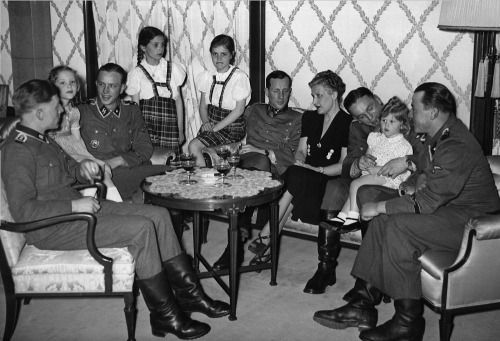 1943 Spring, Magda Goebbels with Helga, Hilde, Holde and Heide, at home with soldiers who took part in the Kharkov Battle. (via indesirableprincesse)