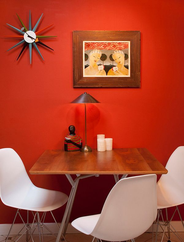 Eccentric dining space proudly showcases the George Nelson Sunburst Clock