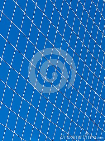 White string net isolated on blue sky. Volleyball or soccer net detail.